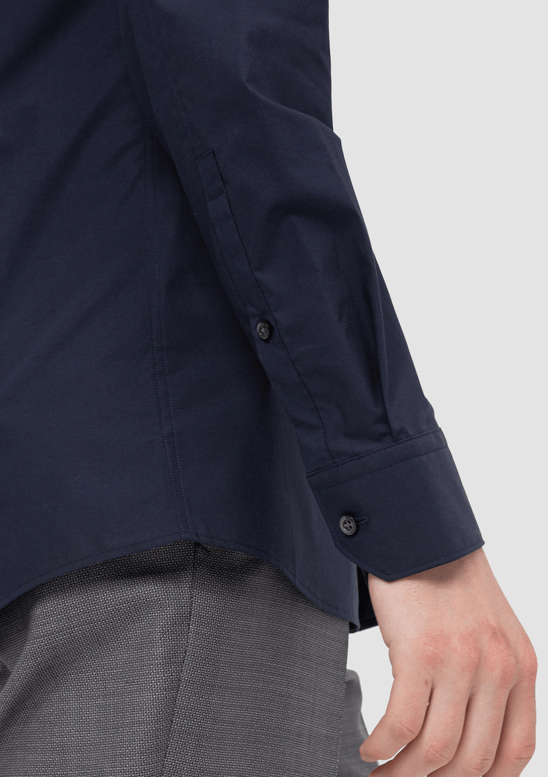 the cuff and button details on the Hugo slim fit Elisha business shirt in navy pure cotton