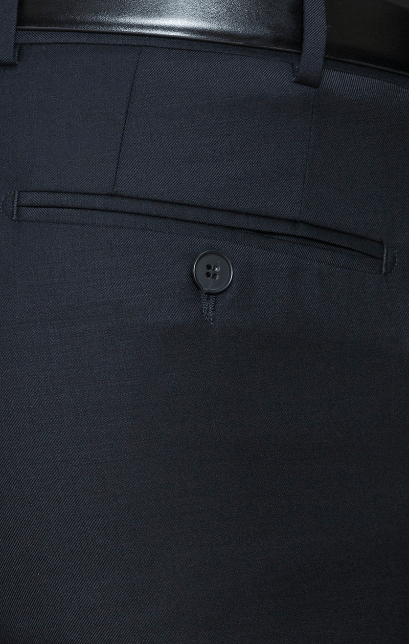 a close up view of the pocket detail on the cambridge interceptor trousers in navy wool blend F262