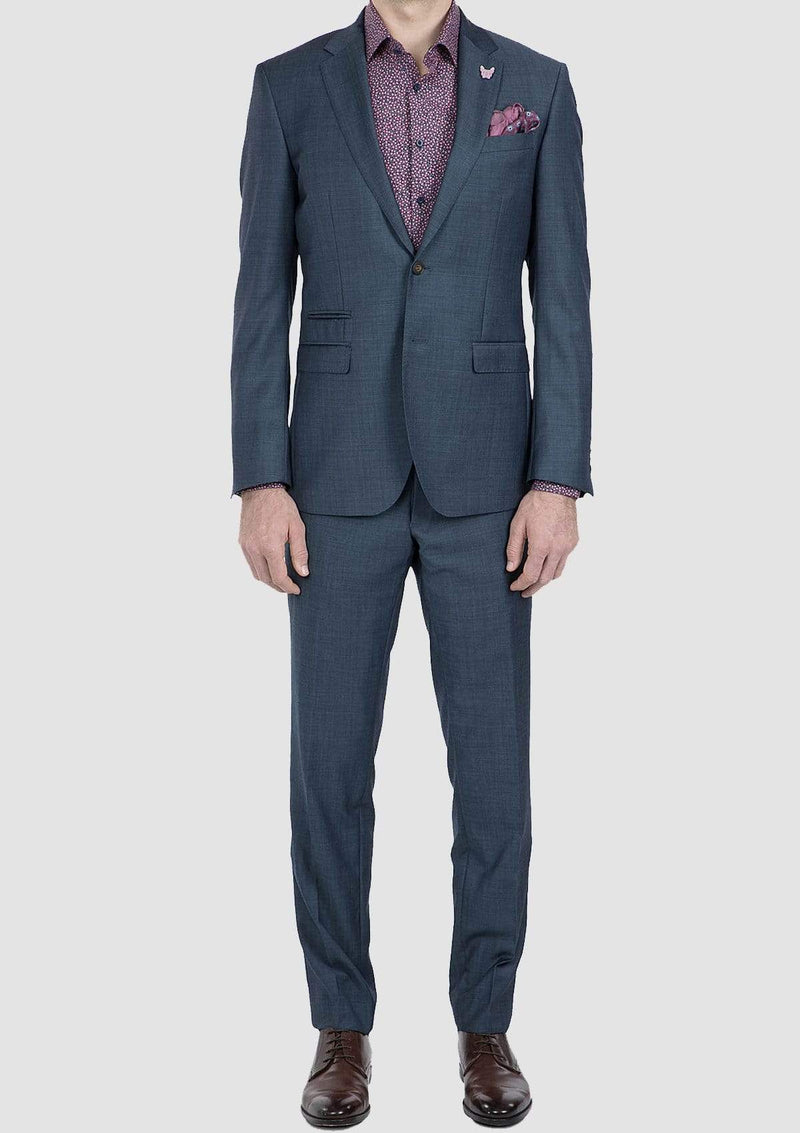 a full length view of the gibson slim fit beta mens suit in balue pure wool