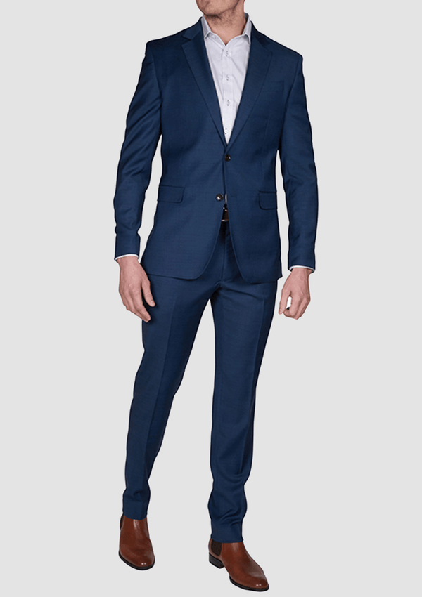 a full length view of the jeff banks slim fit performance mens business suit in navy bue wool lycra blend K386021