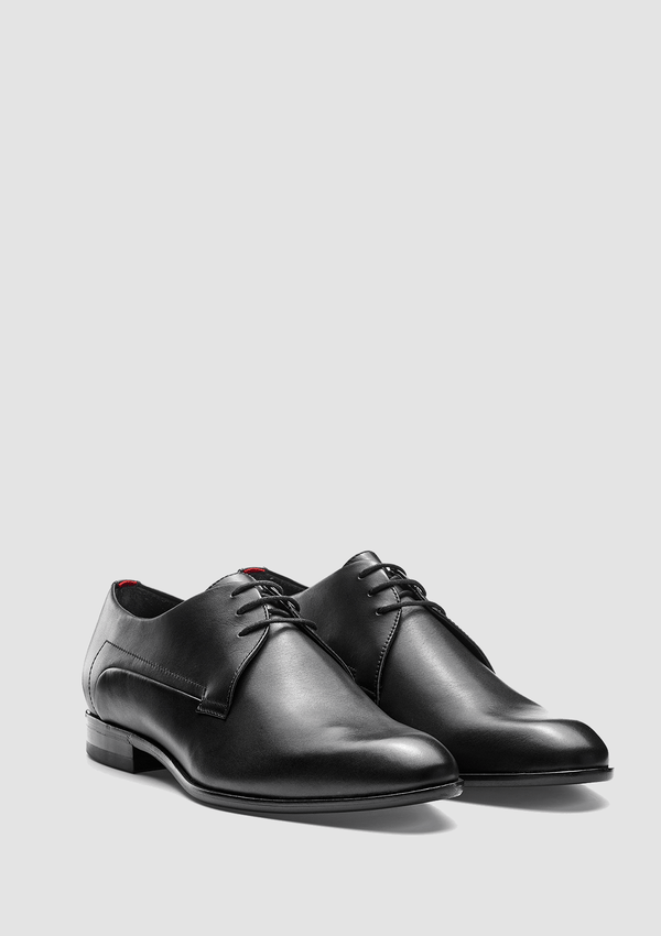 a side view of the hugo boss derby smooth mens leather shoes in black
