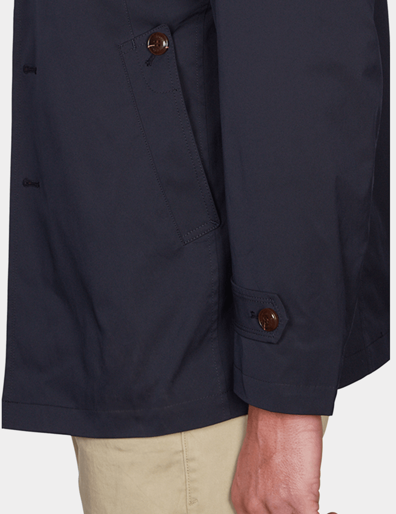 a side view of the slim fit jeff banks mens trench coat in navy K107991094
