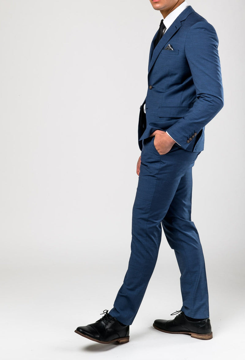 a model wears the aston leon slim fit trouser in blue A042682T styled together with the matching Leon suit jacket