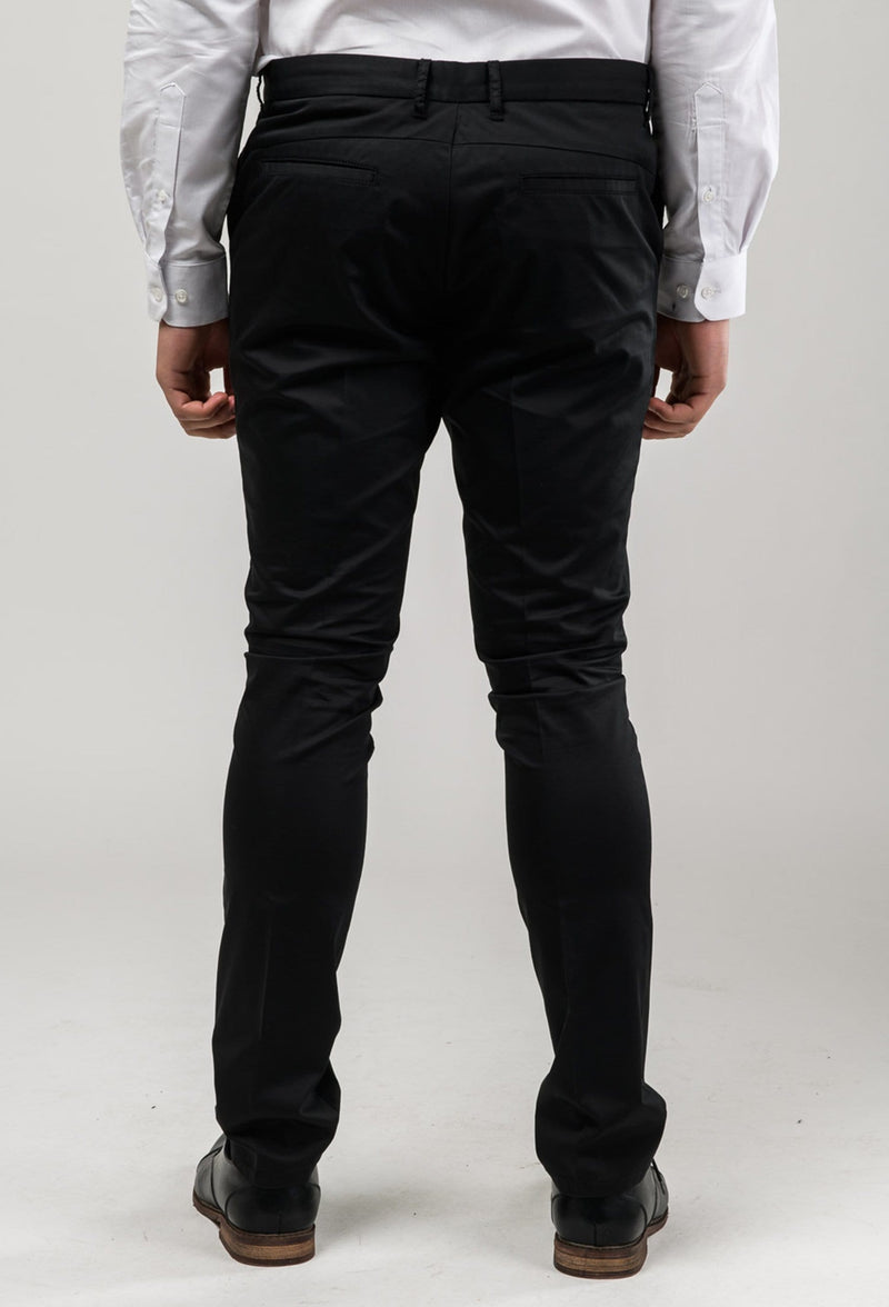 a back view of a model wearing the aston slim fit cooper chino trousr in black stretch cotton A915801