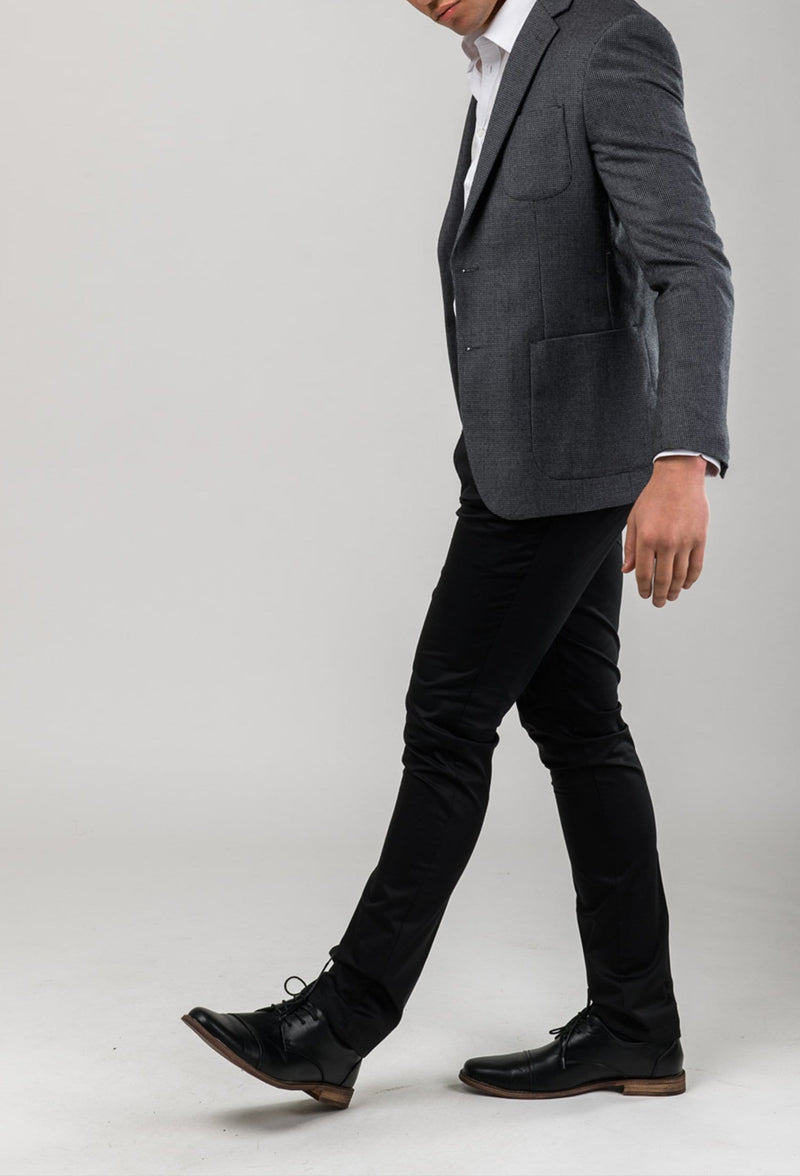 a side view of a model wearing the aston slim fit cooper chino trousr in black stretch cotton A915801