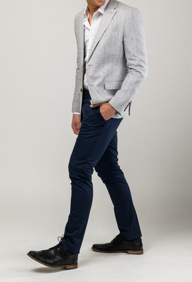 a model walking while wearing the aston slim fit cooper chino trouser in navy stretch cotton A177449