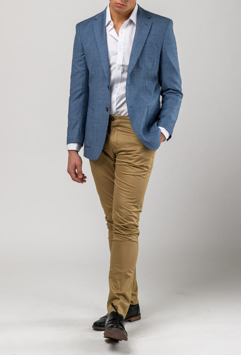 A model front on wear the Aston slim fit franklin sports jacket in blue pure wool A0538157SP a stylish looking blue blazer layered with camel chinos