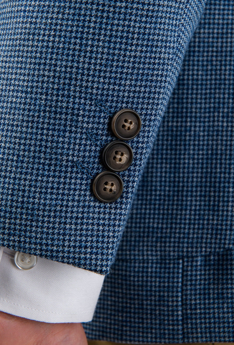 A close up of the sleeve button detail on the Aston slim fit franklin sports jacket in blue pure wool A0538157SP a stylish looking blue blazer layered with camel chinos