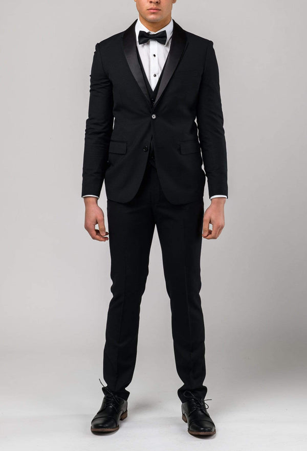 a front view of the Aston slim fit laneport dinner suit in black A019301S styled with a black bow tie and a white shirt