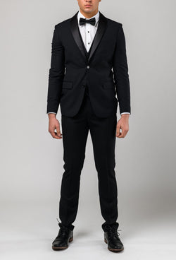 A full length view of the Aston slim fit laneport trouser in black A019301T styled within the suit