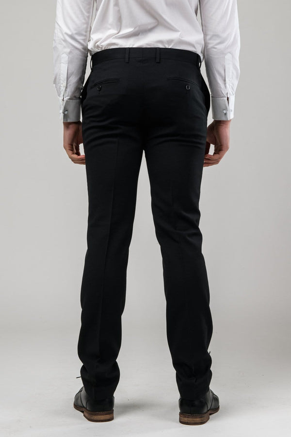 A reverse view of the trouser in the Aston slim fit laneport trouser in black A019301T