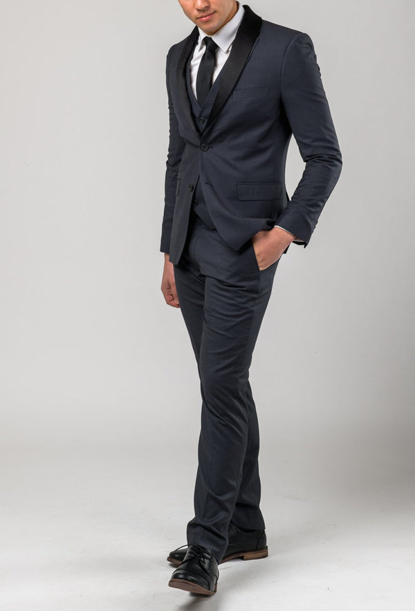 a full length view of the Aston slim fit laneport trouser in charcoal A019301T styled with the matching suit jacket