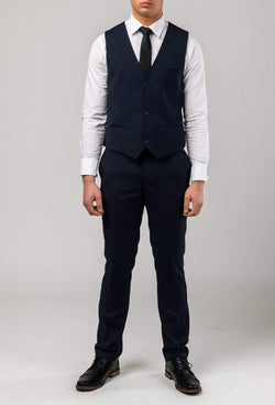 a full length view of the Aston slim fit laneport vest in navy A049301V styled with the lane port trouser