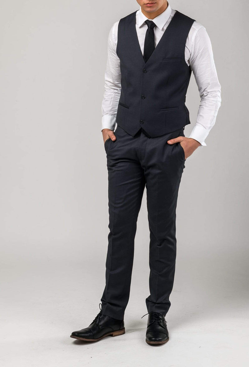 A full length view of the Aston slim fit laneport vest in charcoal A029301V styled with the lane port trouser and a crisp white shirt