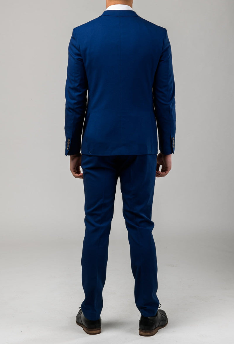 a back view of a model wearing the Aston slim fit leon suit in blue A042718S