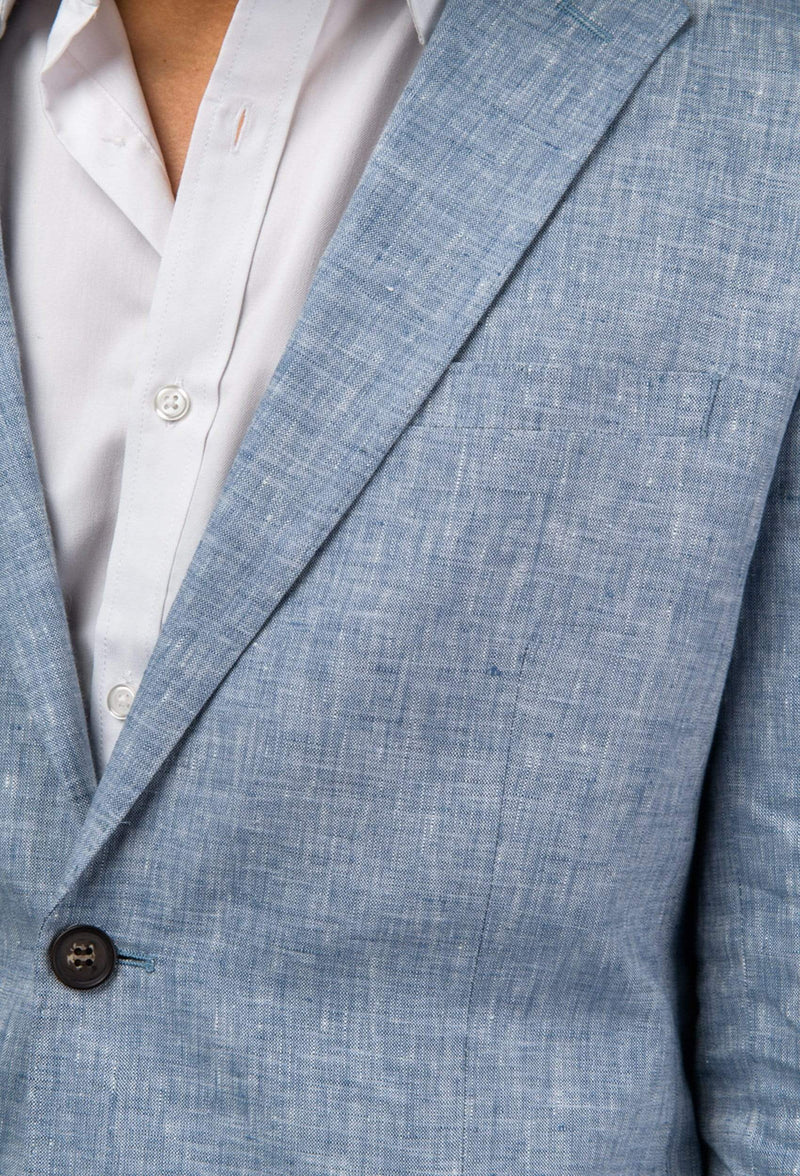 a close up view of the lapel detail on the aston slim fit miller sports jacket in blue pure linen A041019