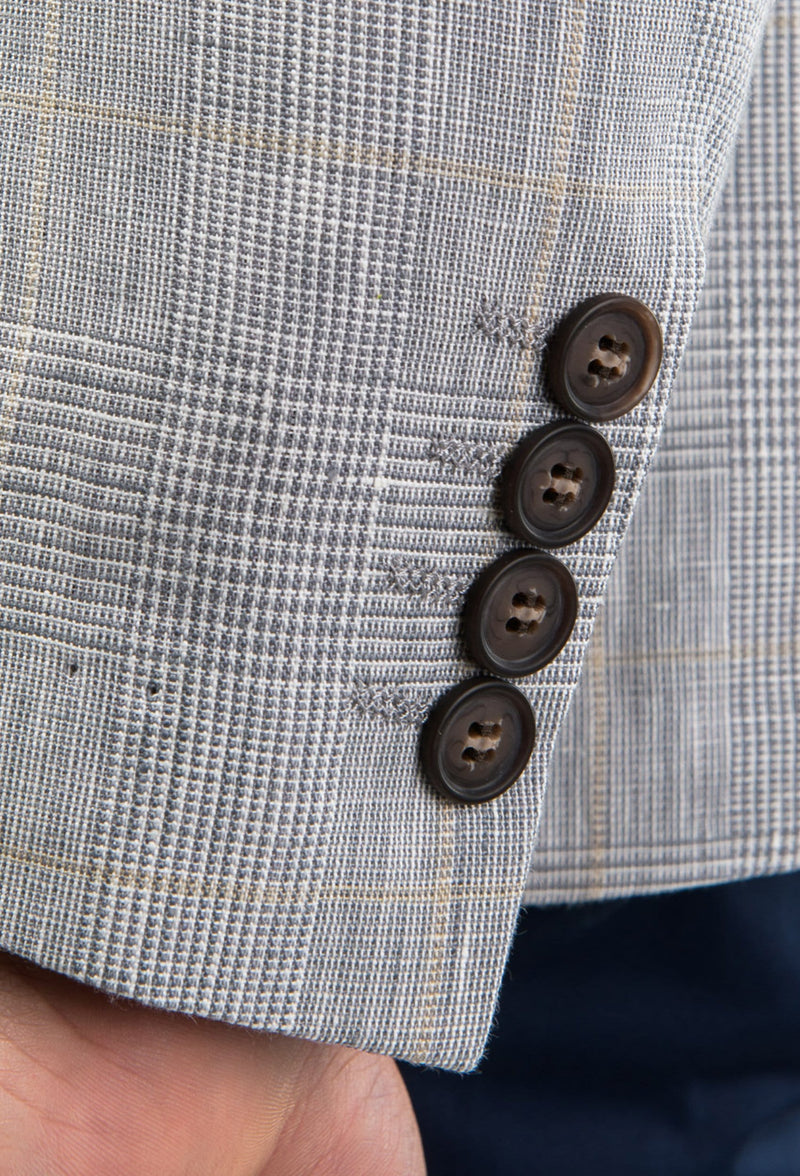 a close up of the sleeve button detail on the Aston slim fit miller sports jacket in grey pure linen