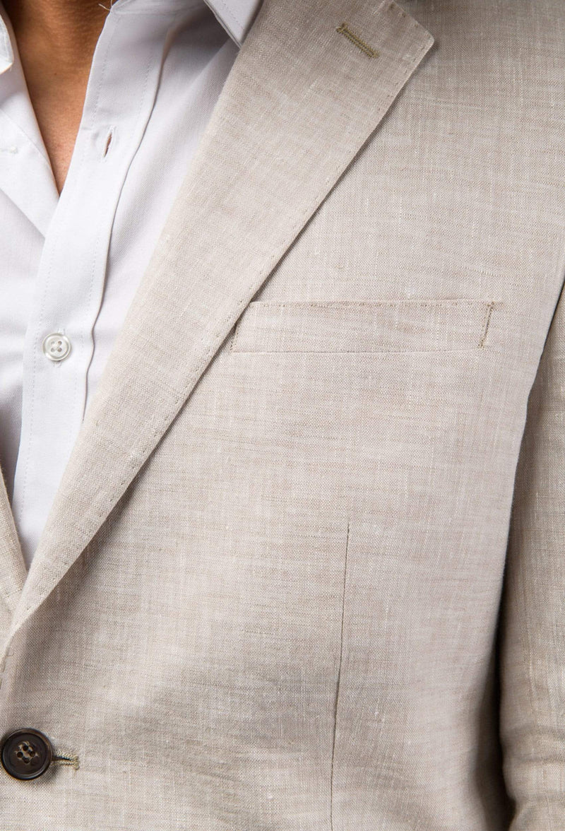 a close up of the lapel detail of the Aston slim fit miller sports jacket in beige linen A091013