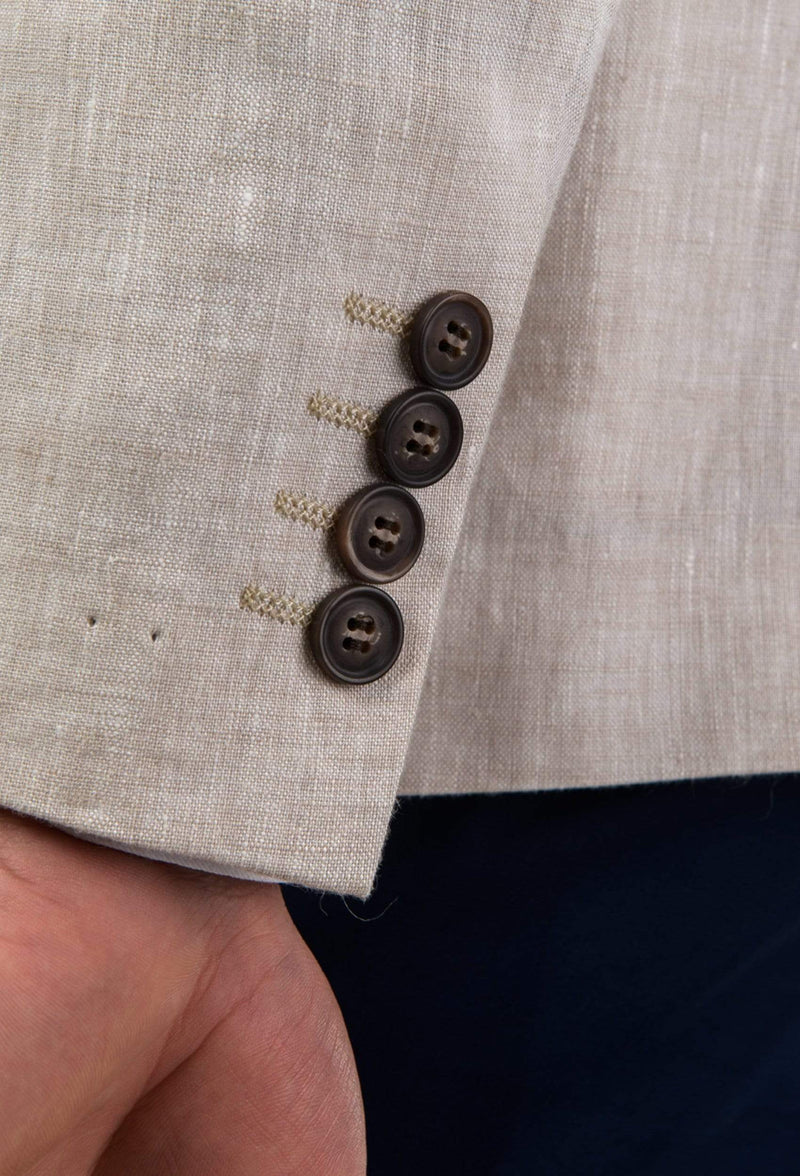 the sleeve button detail of the Aston slim fit miller sports jacket in beige linen A091013
