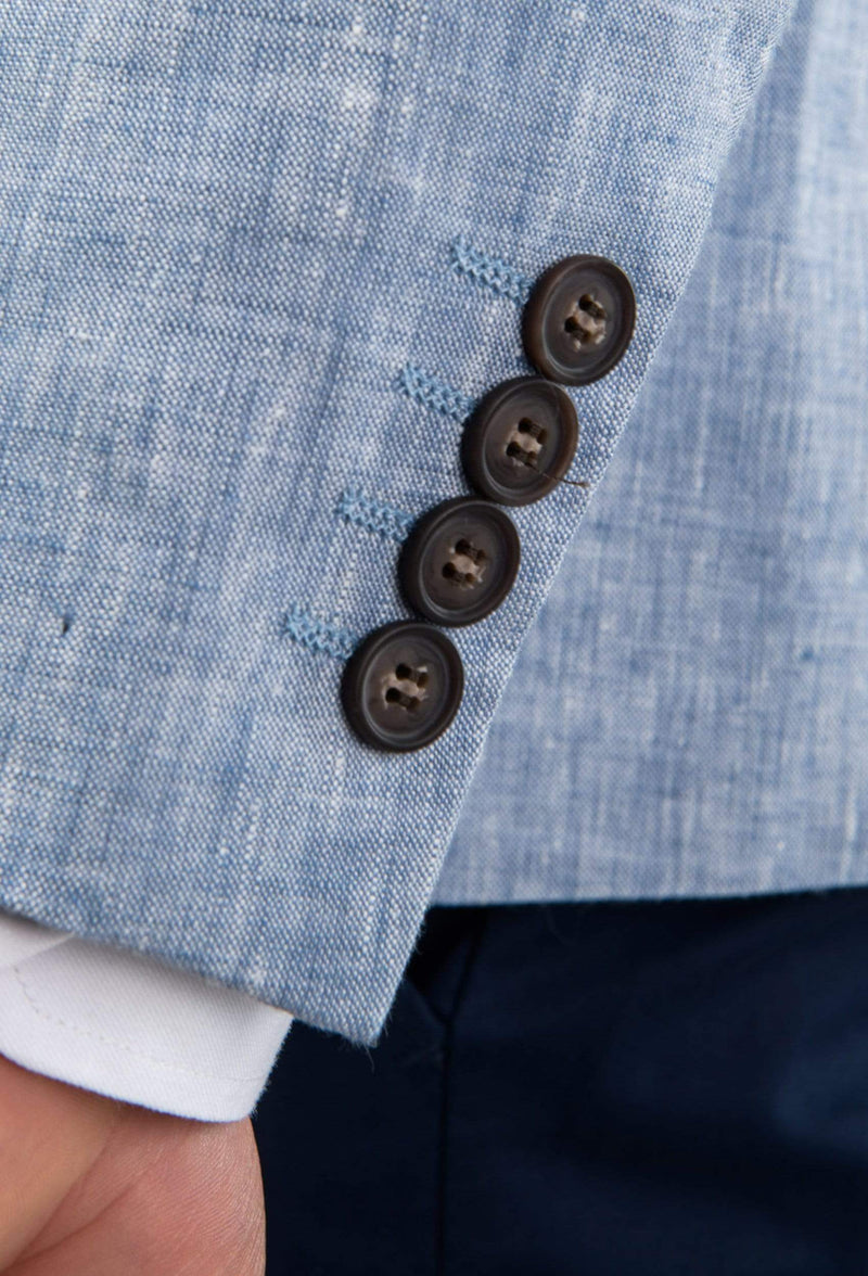 a close up view of the sleeve buttons on the aston slim fit miller sports jacket in blue pure linen A041019