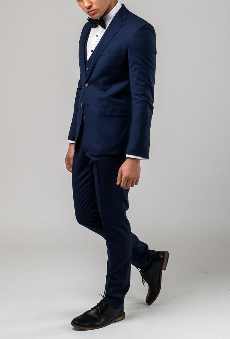 a side view of the Aston slim fit moores suit in royal blue A059301-NL