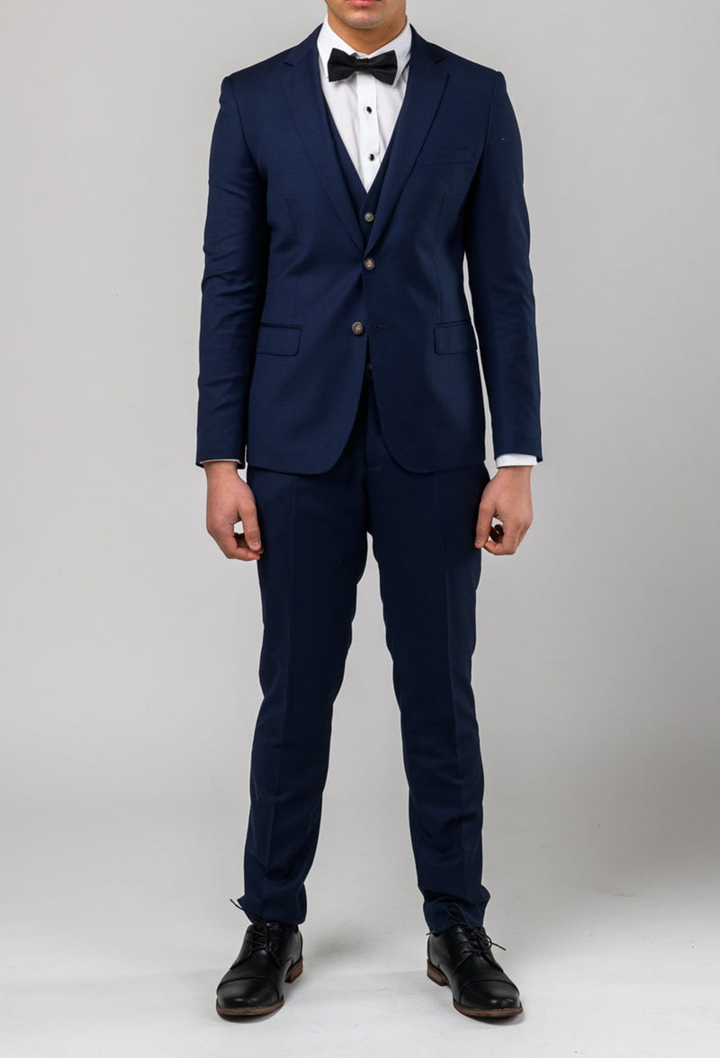 a front view of a model wearing the Aston slim fit moores suit in royal blue A059301-NL