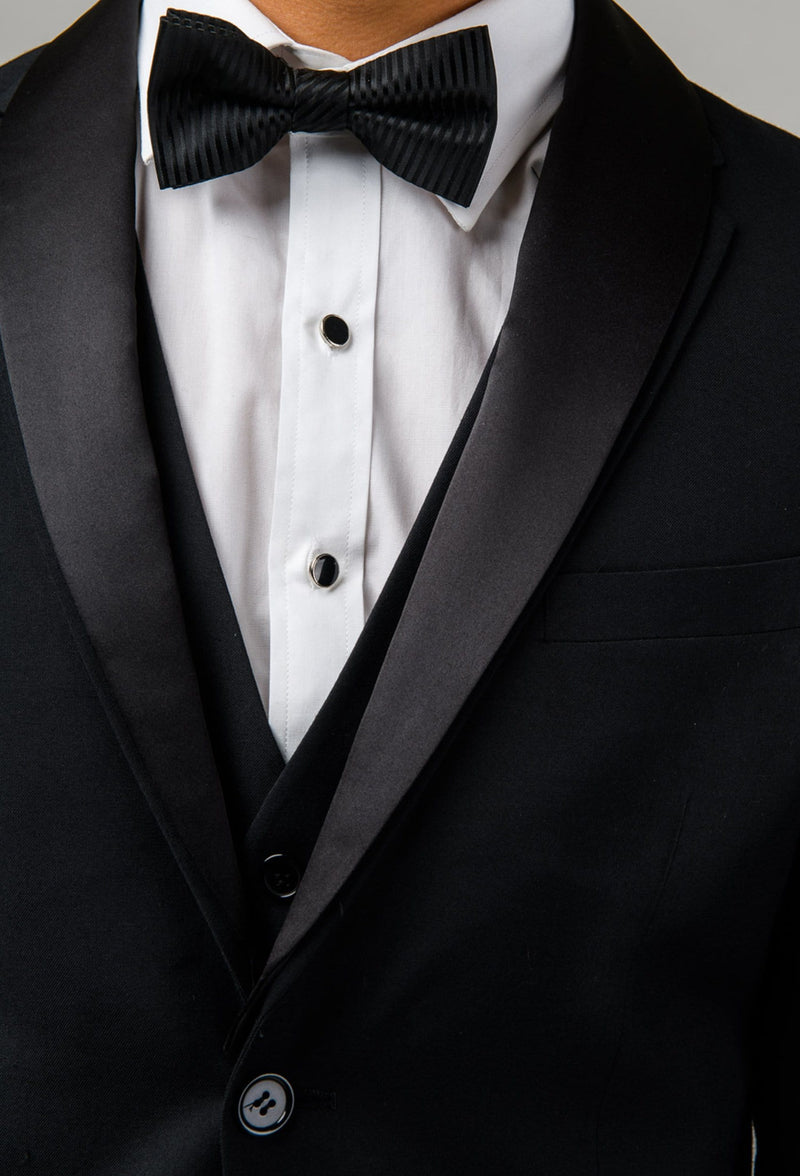 A close up view of the details on the Aston slim fit shaun dinner vest in black pure wool A012710V