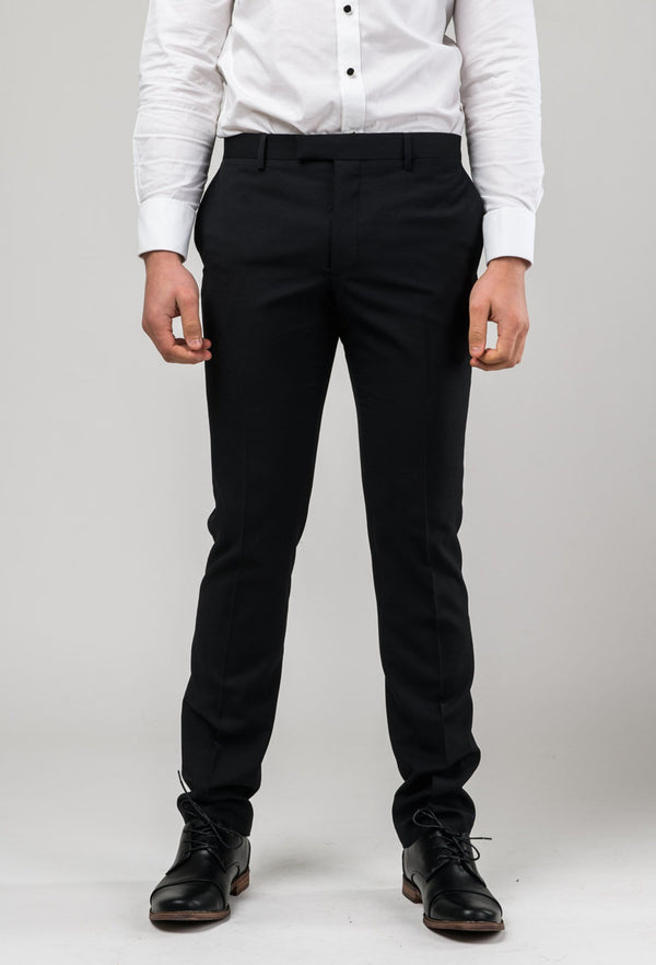 picture of a model front on wearing the shaun Pure wool dinner trouser in black pure wool A012710T