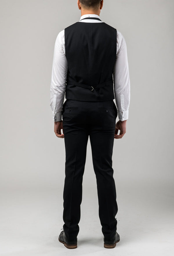 A picture of a model from the back wearing the Aston slim fit shaun dinner vest in black pure wool A012710V