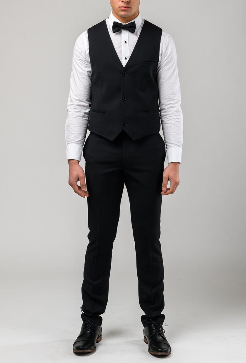 A picture of a model front on wearing the Aston slim fit shaun dinner vest in black pure wool A012710V