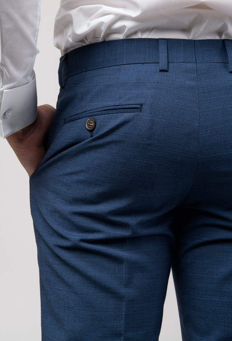 A close up view of the rear hip pocket on the aston leon slim fit trouser in blue A042682T