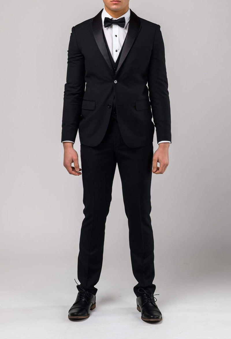a full length view of the aston slim fit shaun mens dinner suit in black pure wool A012710S