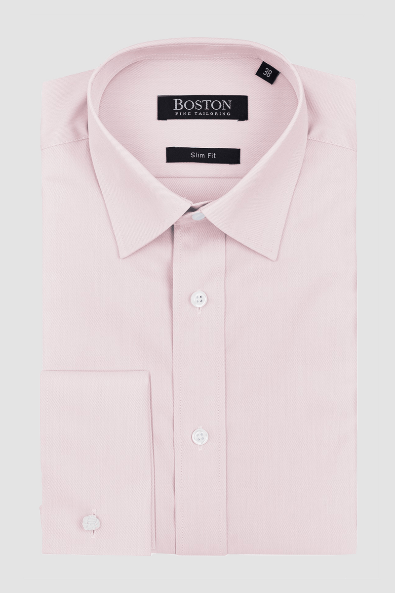 the liberty french cuff mens business shirt in pink cotton folded on a plain background showing the collar shape and crisp finish