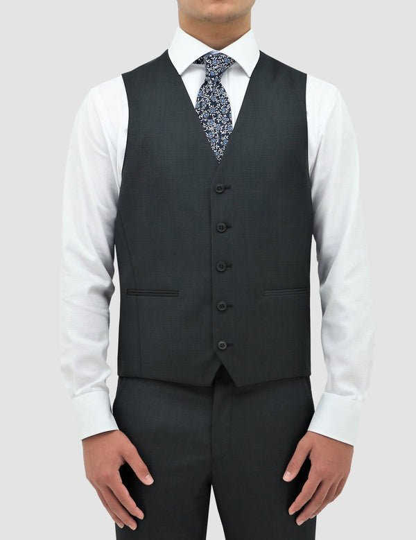 a model wears the classic fit boston ryan vest in charcoal pure wool layered over a white shirt