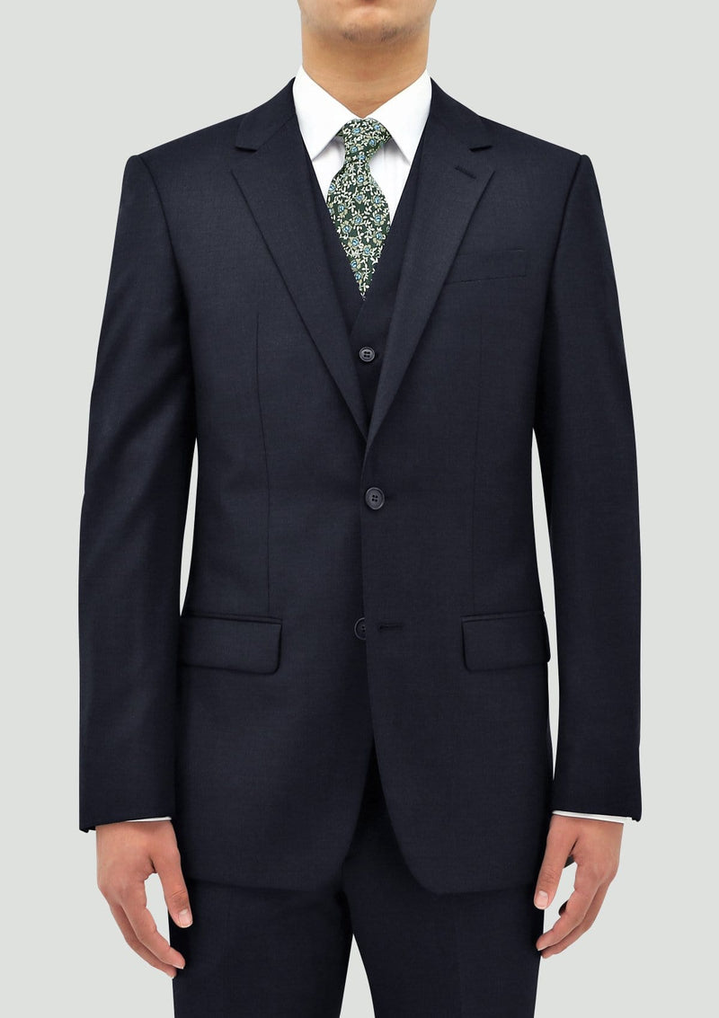 a front view of a model wearing the boston classic fit michel mens suit including the jacket and vest in navy blue wool STB106-11
