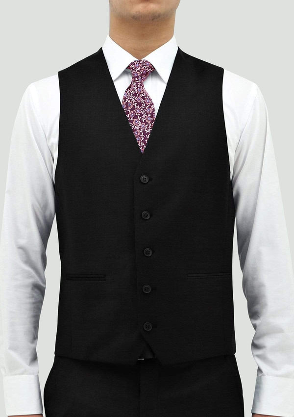 a front view of a model wearing the boston classic fit ryan mens suit vest in black pure wool STB106-01