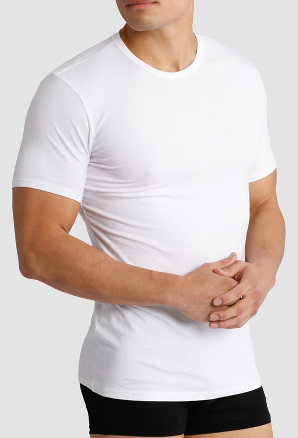 a close up view of a model wearing the Calvin Klein crew neck stretch cotton t-shirt with a black trunk
