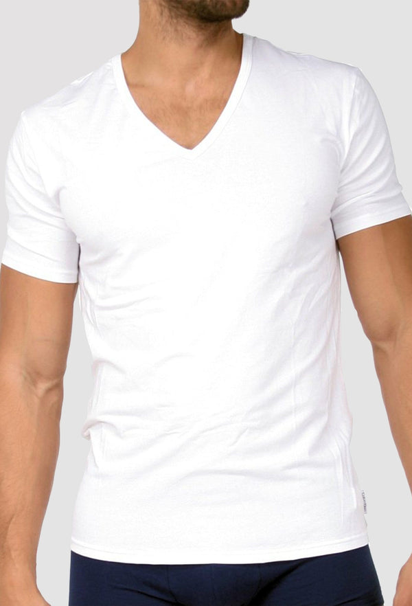 a model wears the Calvin Klein v neck t-shirt in white cotton with a plain black trunk on the bottom