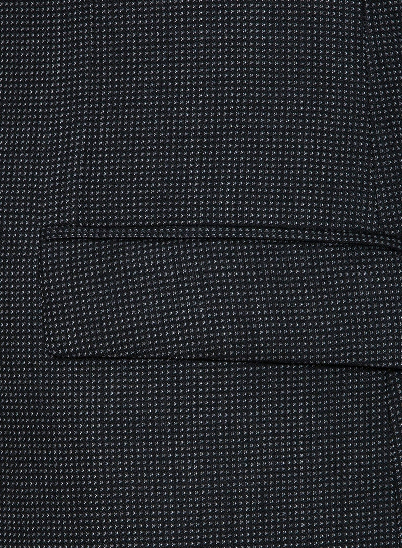 a close up view of the pocket on the Cambridge classic fit cardiff sports jacket in charcoal pure wool, styled with a white shirt FCB035