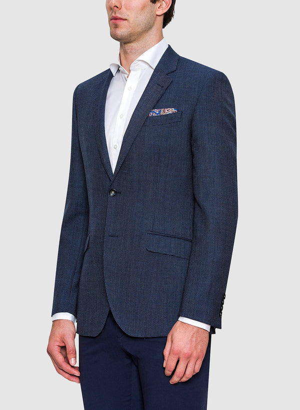 A model wears the Cambridge classic fit cardiff sports jacket in navy pure wool FCB035 a view of the side