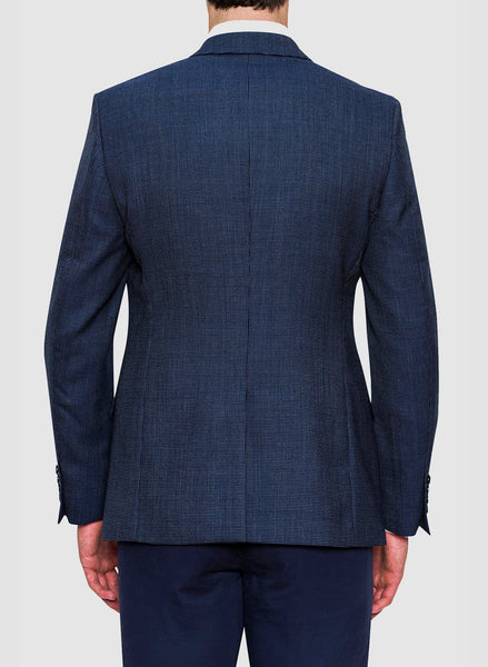 A model wears the Cambridge classic fit cardiff sports jacket in navy pure wool FCB035 a view of the back