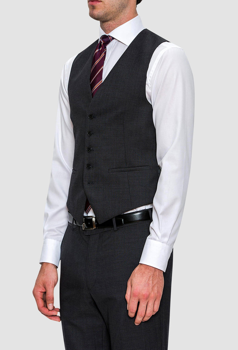 A model wears the Cambridge classic fit beaumont vest in charcoal pure wool F2800 styled with a white shirt