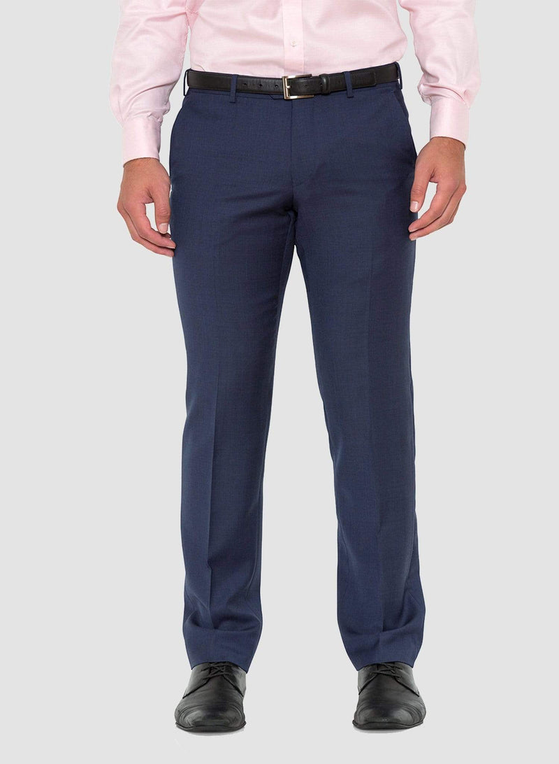 A close up view of the trouser in the Cambridge classic fit morse suit in blue pure wool FCD001 a front view styled with a pink shirt