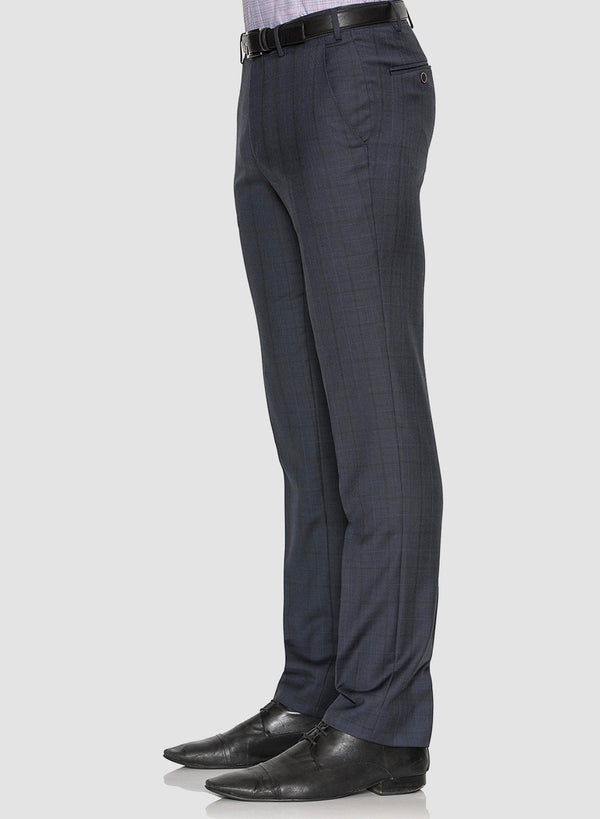 A side view of the Cambridge classic fit interceptor trouser in navy pure wool FCE481 styled with a black shoe