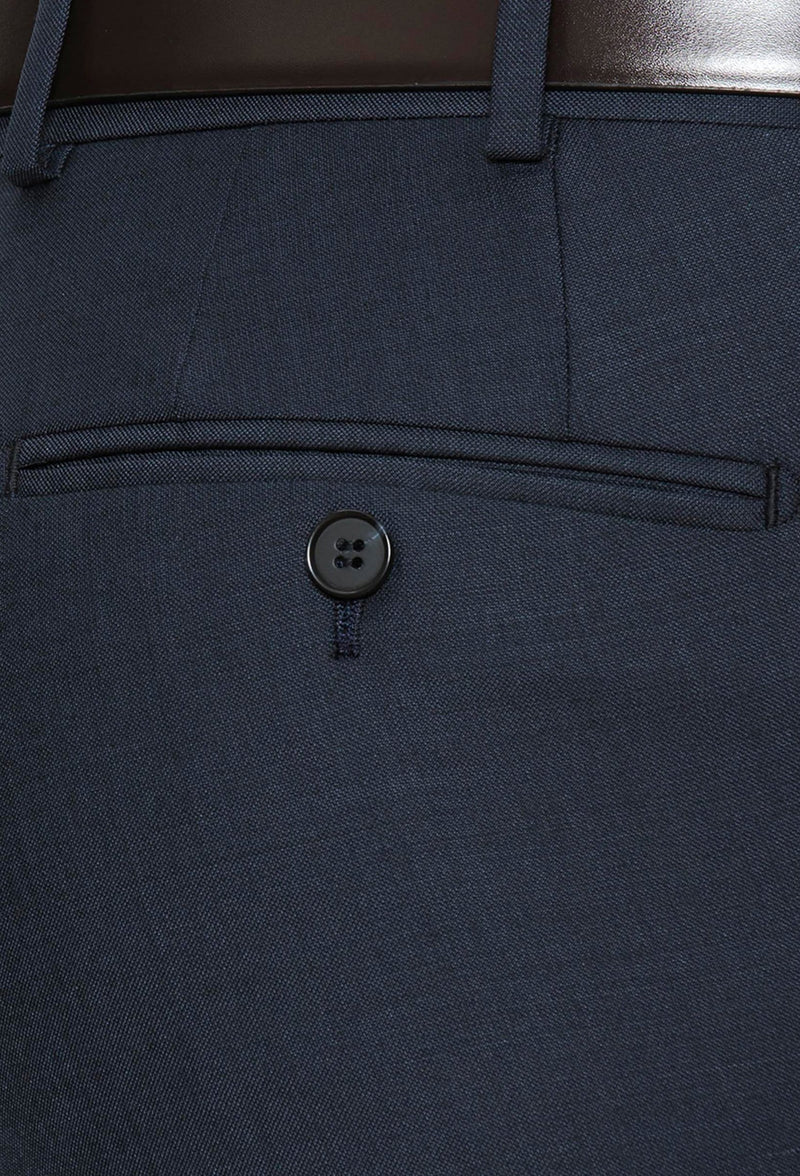 a close up view of the rear pocket detail on the cambridge jett trouser in navy F2042