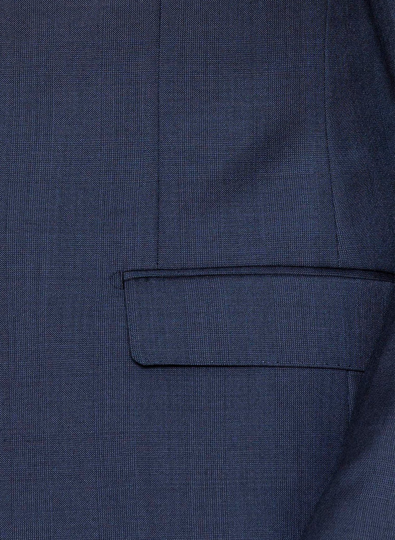 A close up view of the straight flap pocket detail of the jacket in Cambridge classic fit morse suit in blue pure wool FCD001