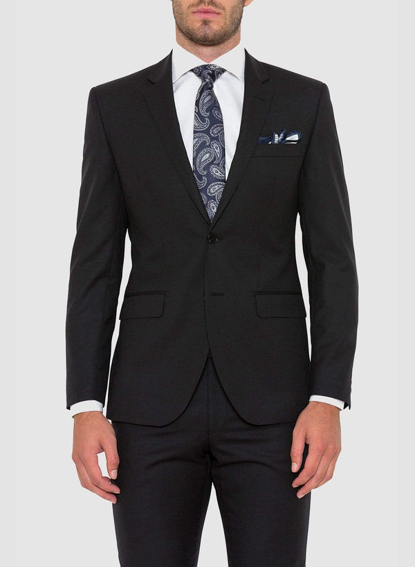 a model wears the cambridge slim fit range suit in black pure wool F275 facing the front