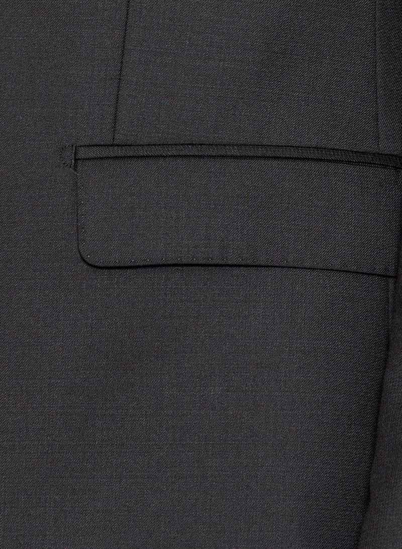 a close up view of the flat pocket detail on the a model wears the cambridge slim fit range suit in black pure wool F275