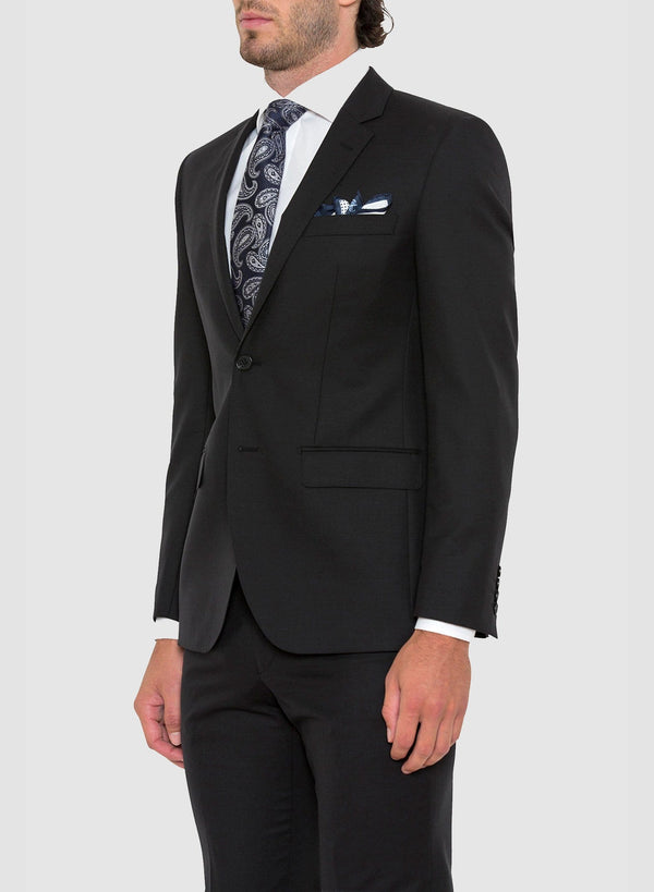 a model wears the cambridge slim fit range suit in black pure wool F275 facing the side
