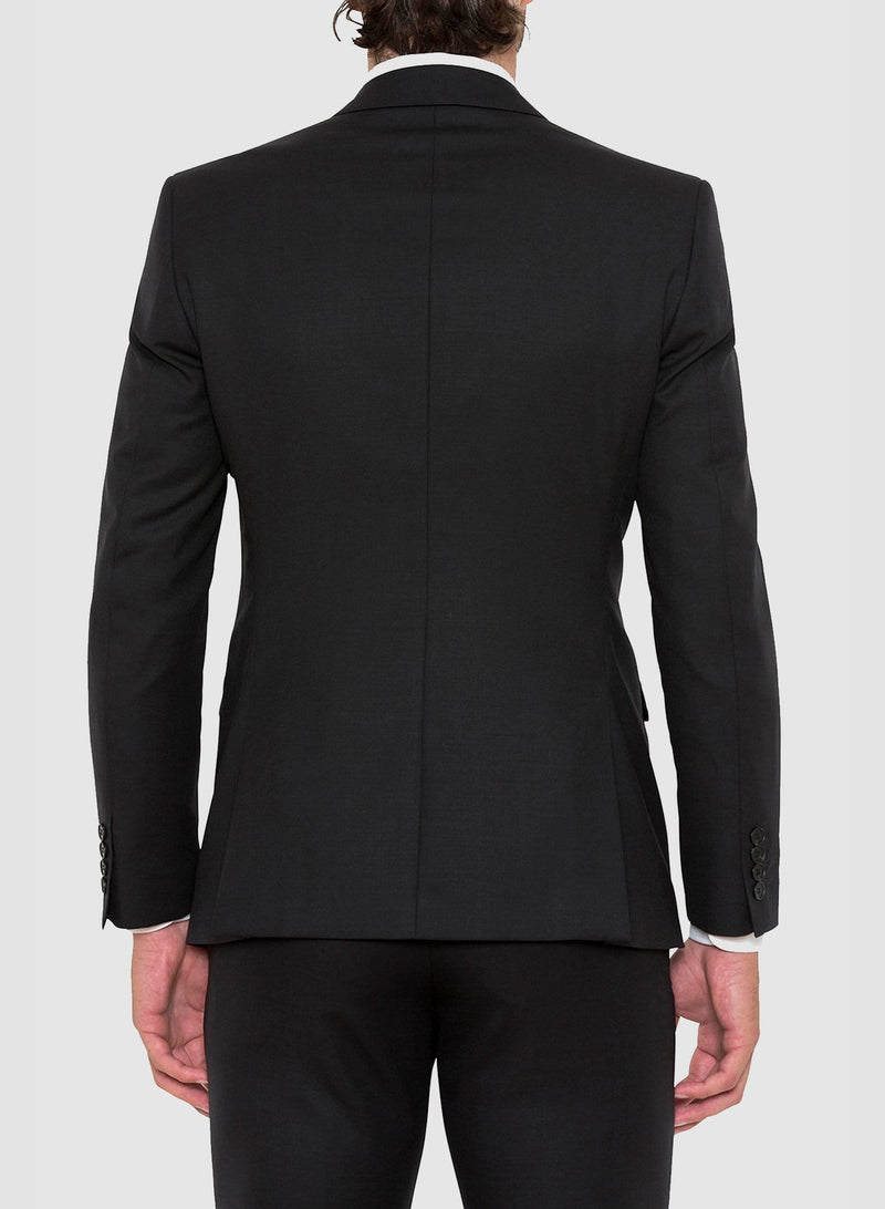 a model wears the cambridge slim fit range suit in black pure wool F275 facing the back